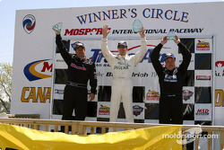 The podium: race winner Scott Pruett with Michael Lewis and Johnny Miller
