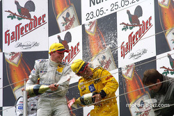 The podium: champagne for race winner Christijan Albers and Laurent Aiello