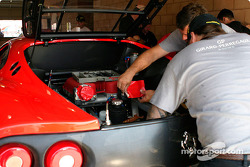 Mechanics work on the #33 Ferrari