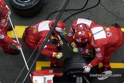 Ferrari team members at work during Michael Schumacher's pitstop