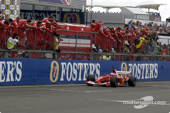 Rubens Barrichello and Ferrari team members celebrate victory