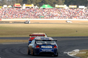 Mark Larkham in the Orrcon Ford chasing Cameron McConville in the Lansvale Smash Repairs Commodore