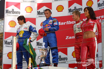 The podium: race winner Christian Klien with Nelson A. Piquet and Ryan Briscoe