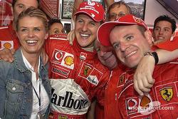 Race winner Michael Schumacher celebrate with wife Corinna, Jean Todt and Rubens Barrichello
