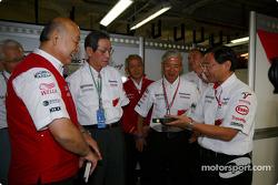 Kunio Nakamura, President of Panasonic is given a Toyota garage tour by Toshiro Kurusu, Tsutomu Tomita, Akihiko Saito, EVP Toyota Motor Corporation, and Keizo Takahashi