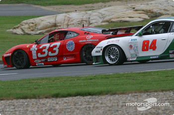 #33 Scuderia Ferrari of Washington Ferrari 360GT: Cort Wagner, Brent Martini, and #84 Acme Motorsport Porsche GT3 RS: Mark Hupfer, Paul Mortimer, Tim McKenzie