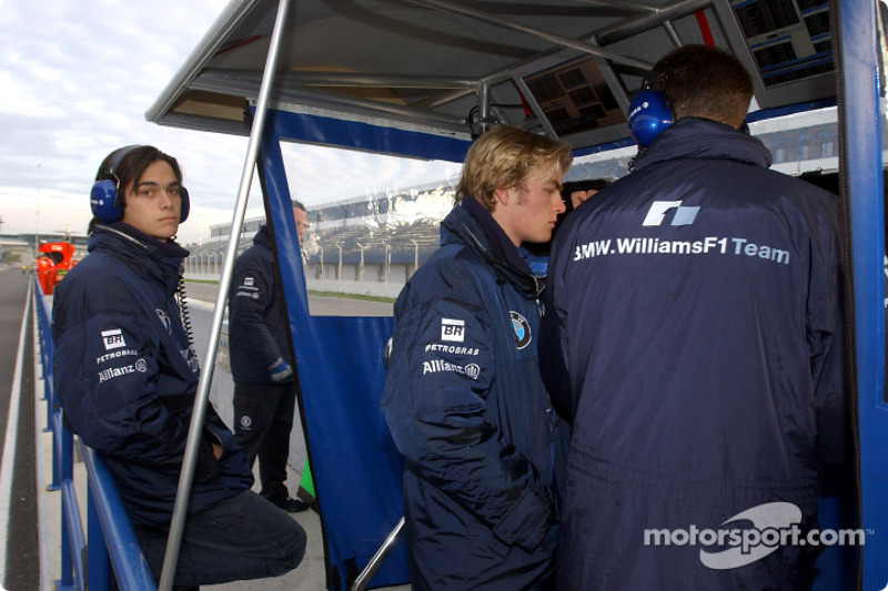 Nelson A. Piquet and Nico Rosberg at the pitwall