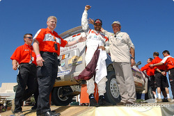 Nasser-Saleh Al-Attiyah and Marc Bartholome celebrate on the finish podium