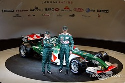 Christian Klien and Mark Webber pose with the new Jaguar R5
