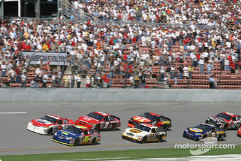 First lap: Greg Biffle battle with Dale Earnhardt Jr. for the lead