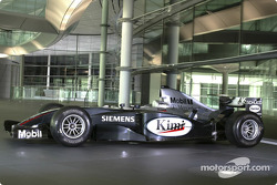 Team McLaren Mercedes Formula One car in front of the Schüco manufactured facade at the McLaren Technology Centre