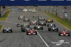 Start: Michael Schumacher takes the lead ahead of Rubens Barrichello