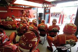 Ferrari team members watch the race