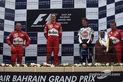 Podium: race winner Michael Schumacher with Rubens Barrichello and Jenson Button