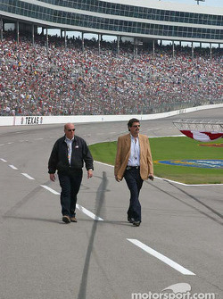 Mike Helton inspects pre race activities