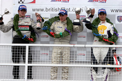 Podium: race winner Adam Carroll with Nelson A. Piquet and James Rossiter