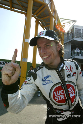 Jenson Button celebrates first pole position in career