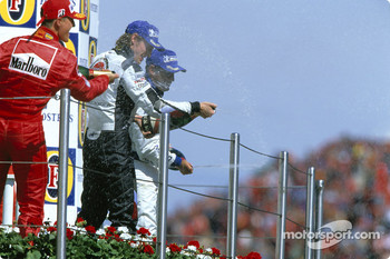 Podium: champagne for Michael Schumacher, Jenson Button and Juan Pablo Montoya