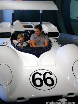 Gil de Ferran and son sitting in 2E mock-up