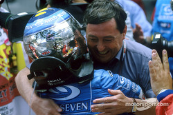 Jarno Trulli celebrates victory with Patrick Faure