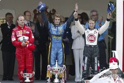 Podium: race winner Jarno Trulli with Jenson Button and Rubens Barrichello