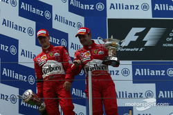 Podium: race winner Michael Schumacher with Rubens Barrichello