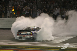Race winner Jimmie Johnson smokes the tires