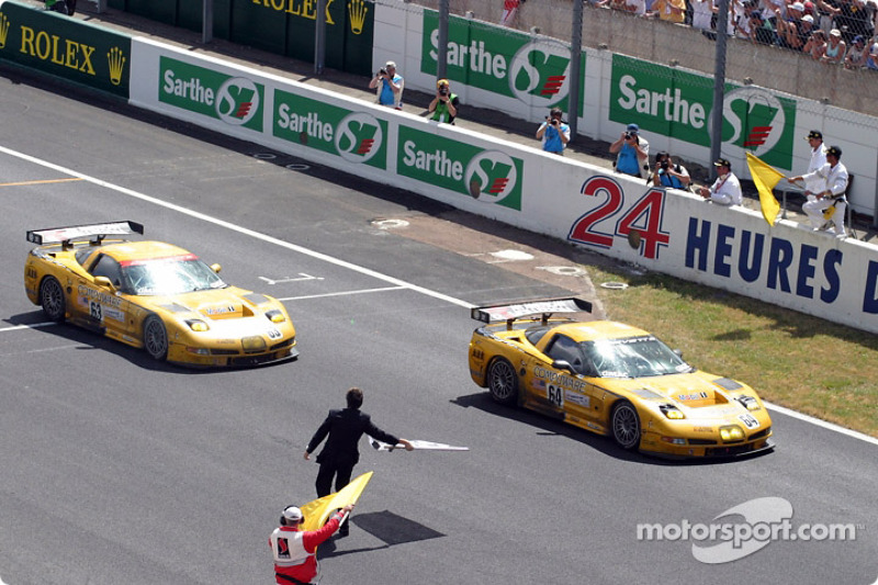 The winning Corvettes take the checkered flag