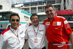 Ross Brawn celebrates victory with Bridgestone team members
