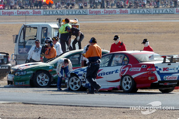 Greg Murphy and John Bowe inspect the damage