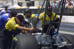 Crew pushes John Smith's car back the the garage