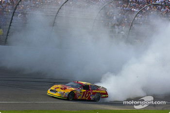 Greg Biffle smokes the tires