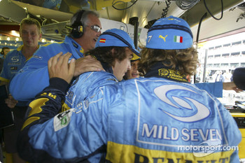 Jarno Trulli celebrates pole position with Fernando Alonso and Flavio Briatore