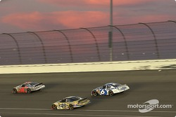 Mark Martin makes his way through traffic as the sun sets on the California Speedway