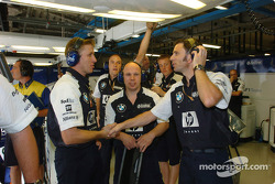 Williams-BMW team members celebrate Juan Pablo Montoya's second place on the starting grid