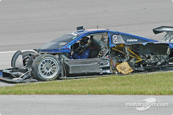 Darren Law sits in the wrecked #58 Brumos Racing Porsche Fabcar
