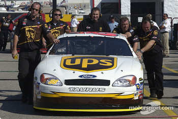 Robert Yates Racing crew push the UPS car in garage area