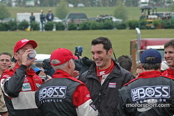 Max Papis congratulates race winners Butch Leitzinger and Elliott Forbes-Robinson