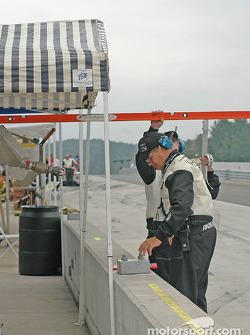 Grand Am officials measure fuel tank heights
