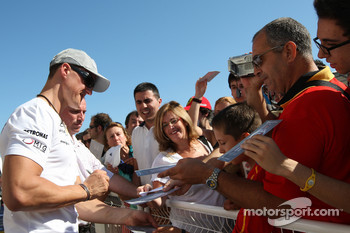 Michael Schumacher, Mercedes GP signs autographs
