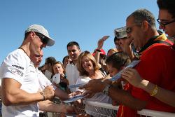 Michael Schumacher, Mercedes GP signs autographs
