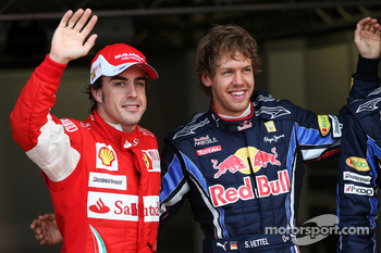 Pole winner Sebastian Vettel, Red Bull Racing, with third place Fernando Alonso, Scuderia Ferrari