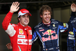 Pole winner Sebastian Vettel, Red Bull Racing, with third place Fernando Alonso, Scuderia Ferrari