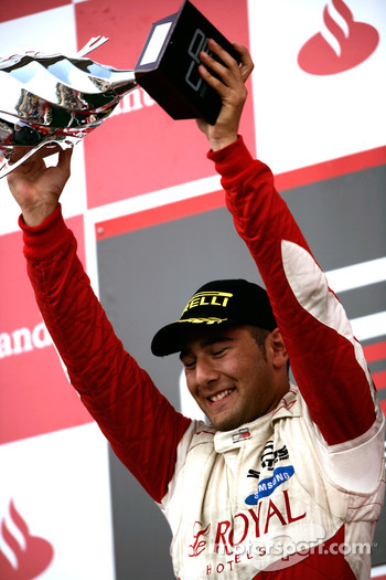 Daniel Morad celebrates victory on the podium