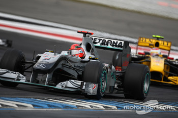 Michael Schumacher, Mercedes GP leads Vitaly Petrov, Renault F1 Team