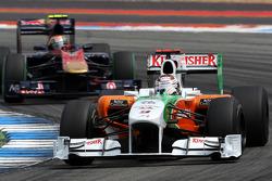 Adrian Sutil, Force India F1 Team leads Jaime Alguersuari, Scuderia Toro Rosso