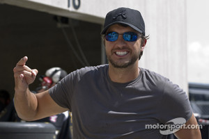 Luke Bryan walks around in the garage area
