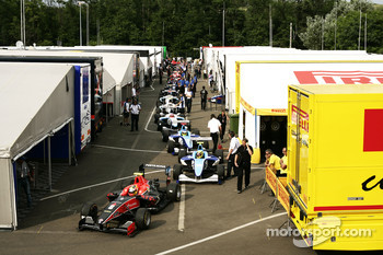 Adrien Tambay, Rio Haryanto and Adrian Quaife-Hobbs leave the paddock with the field