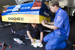 The Miller Lite crew makes repairs to the No. 2 Dodge