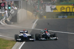 Rubens Barrichello, Williams F1 Team and Michael Schumacher, Mercedes GP